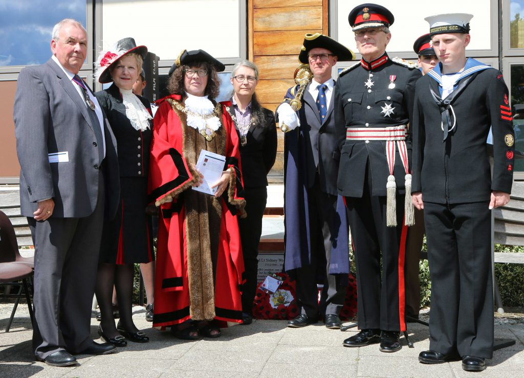 Unveiling of the memorial to Sidney Woodroffe VC. From left: Cllr Colin Belsey, chairman of East Sussex County Council, Juliet Smith, High Sheriff of East Sussex, Cllr Susan Murray, Mayor of Lewes, Cllr Ruth O'Keeffe, chairman of Lewes District Council, Lee Symons, Lewes Town mace bearer, Peter Field, Lord Lieutenant of East Sussex, Cadet from Brighton Sea Cadets