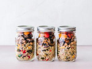 Food in jars being stored to reduce food waste.