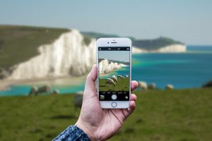 Person taking a picture of seven sisters.