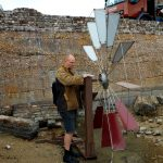 Christian Funnell testing out his water wheel installation